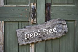 stock photo of debt free  - I am debt free sign on green doors - JPG