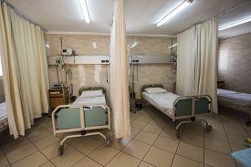 pic of icu  - Beds in a hospital ICU ward room  - JPG