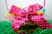 pic of poka dot  - A huge pink bow on an Easter basket.