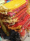 foto of charminar  - Fine silk brocade saree fabric in Lad Bazaar in Charminar Hyderabad Andhra Pradesh India Asia - JPG