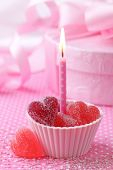 image of jelly babies sugar  - Pink candle with red heart candies close up - JPG