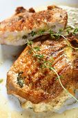 picture of pork chop  - Pork chops stuffed with cheese made on the grill - JPG