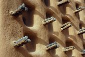 foto of dogon  - A horizontal image of the side wall of a Dogon mud mosque - JPG