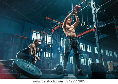 poster of Fit Young Man Lifting Weight Working Out At A Gym. Sport, Fitness, Weightlifting, Bodybuilding, Trai