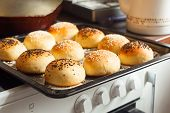 Tasty Buns With Sesame. Freshly Baked Buns. Hot, Fresh From The Oven Hamburger Buns. Homemade Brioch poster