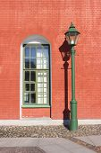 Brick Wall House Window And Street Lantern On Old Town Street. Architecture Building Exterior With O poster