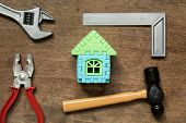 Home Model Object With Toy Equipment Tool On Wood Background (concept For Home Repair Or Fix) poster