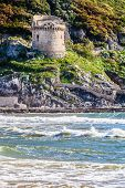 Mediterranean Sea And Historic Sixteenth Century Tower. An Ancient Defense Tower On A Mountain On Th poster
