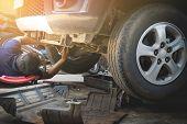 Technician Checking Engine Of Car. Auto Mechanic Checking Car Engine. Maintenance Checking Car. poster