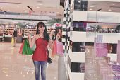 Shopping Concept. Asian Girls Are Shopping In The Mall. Beautiful Women Are Happy To Shop In The Mal poster