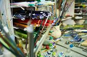 Close Up Of Different Colored Glass Rods With Handmade Beads On Workstation In Glass Working Studio, poster