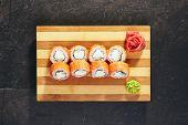 Philadelphia Sushi Roll - Maki Sushi with Philadelphia Cheese inside. Salmon outside. Top View poster