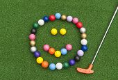 Colorful Mini Golf Ball Happy Face With Orange Putter On Synthetic Grass poster