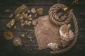 Pirate Gold And Treasure Map Crumpled Parchment With Copy Space, Dagger, Compass And Ship Rope On Ol poster