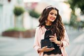 Portrait Of Attractive Brunette Girl With Long Brunette Hair Wearing Pink Jacket, Black Top And Diad poster