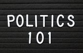 The Words Politics 101 In White Plastic Letters On A Black Letter Board As An Introduction To The Ba poster