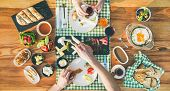 Couple Having Turkish Breakfast. Flat-lay Of Peoples Hands And Traditonal Turkish Cuisine Food For B poster