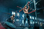 Fit Young Man Lifting Weight Working Out At A Gym. Sport, Fitness, Weightlifting, Bodybuilding, Trai poster