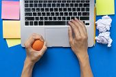 Office Worker Typing Email On Computer, Feels Stressed And Nervous, Holds A Stress Ball In Her Hand poster
