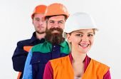 Постер, плакат: Woman And Men In Hard Hats Stand Close As Team Team Of Architects Builders With Happy Faces Isola