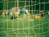 Hang Bended Soccer Nets Soccer Football Net. Grass On Football Playground In The Background poster