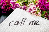 The Inscription Call Me On A White Napkin Left On The Table In A Cafe. Text Call Me On A Background  poster
