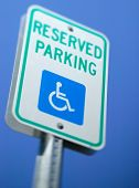 picture of physically handicapped  - A handicap reserved parking sign for those who are physically disabled. ** Note: Shallow depth of field - JPG