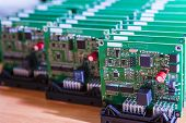 Electronics Ideas. Closeup Of Lot Of Electronic Printed Circuit Boards With Lots Of Surface Mounted  poster