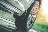 Car Driving In The Rain. Modern Rain Summer Season Tires On The Wet Pavement. Closeup Aquaplaning Ph poster