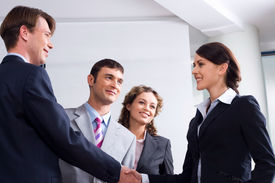 picture of business meetings  - Image of businessman and woman shaking hands at meeting - JPG