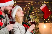 Idyllic Date. Man Woman Santa Claus Hats Cheerful Celebrating New Year. Celebrating Winter Holiday.  poster