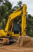 Yellow Excavator On A Construction Site Against Blue Sky. Heavy Industry. Close Up Details Of Indust poster