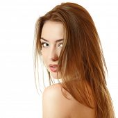 beautiful young female face with long fair hair. Isolated on white background