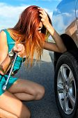 Pretty Girl Is Trying To Change A Tire On A Road