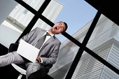 image of hysterics  - Businessman laughing hysterically - JPG