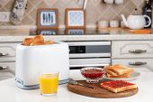 White Toaster, Glass Of Orange Juice, Slices Of Toasted Bread, Crispy Toast With Raspberry Jam And B poster