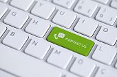 Green Key With Contact Us Icon On White Laptop Keyboard. The Contact Us Button Has A Text And Symbol poster