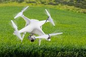 Drone Unmanned Aircraft Flying and Gathering Data Over Country Farmland. poster