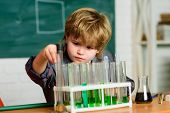 Genius Pupil. Chemical Analysis. Science Concept. Wunderkind Experimenting With Chemistry. Boy Use M poster