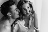 Happy Young Loving Couple Smiling. Young Couple In Love Have Fun I On New Years Eve Or St Valentines poster