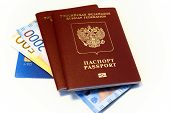 Russian Passports Are On Banknotes And A Bank Card. Credit Card, Money And Russian Passports For Tra poster