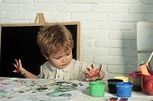 Draw With Fingers. The Child Learns To Draw. Creative Lessons. Preparation For School. The Boy Draws poster