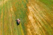 Aerial View Of Rural Landscape. Combine Harvester Working In Field, Collects Seeds. Harvesting Of Wh poster