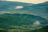 Clouds Rising Above The Hills. Mountainous Countryside Of Carpathians. Fog Evaporate From The Green  poster