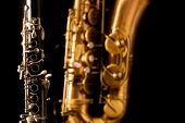 Classic music Sax tenor saxophone and clarinet in black background