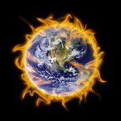 stock photo of global-warming  - planet earth engulfed in flames is a metaphor for global warming - JPG