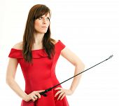 stock photo of riding-crop  - beautiful woman in a red dress holding a riding crop on white background - JPG