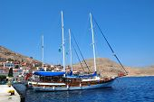 HALKI, GREECE - JUNE 14: Turkish registered tourist boats moored in Emborio harbour on June 14, 2010