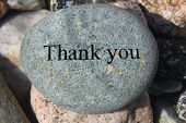 image of give thanks  - Positive reinforcement word Thank You engrained on a rock - JPG