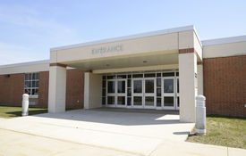 image of entryway  - entrance for a modern school with a covered entryway and sidewalk - JPG